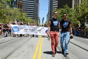Wells Fargo Point Scholar (right) marches with his fiancé Andrew (photo by: Megan Prakash)